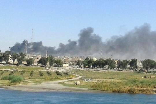 "Syrian regime air strike on Raqqa, September 6, 2014. (Photo by ""Akram)"