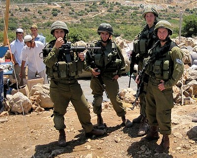 Israeli Soldiers Guard Settlers at an Illegal Outpost near Hebron. Photo by Joseph Dana