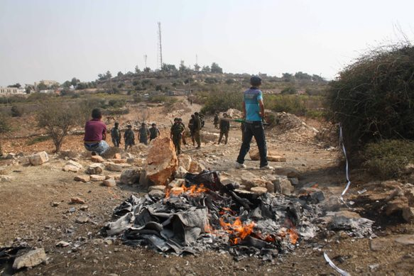 Palestinians Burn Settlment Products in Front of the Karmei Tzur Settlement. Picture Credit: Joseph Dana