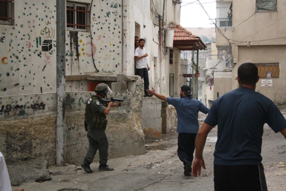 A Palestinian Pleads with an Israeli Border Policeman to Stop Firing Tear Gas in Silwan. Photo by Joseph Dana.