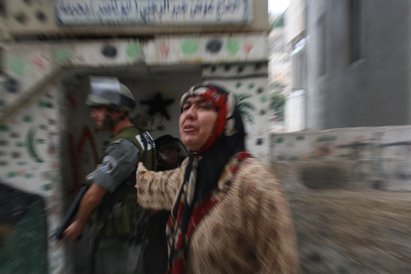 Pain on the Face of a Palestinian Woman in Silwan. Photo by Joseph Dana