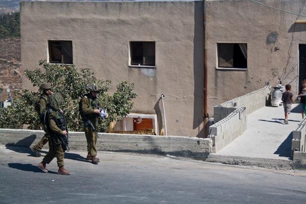 Israeli Soldiers Looking for Children to Arrest in Nabi Salih. Photo By Joseph Dana
