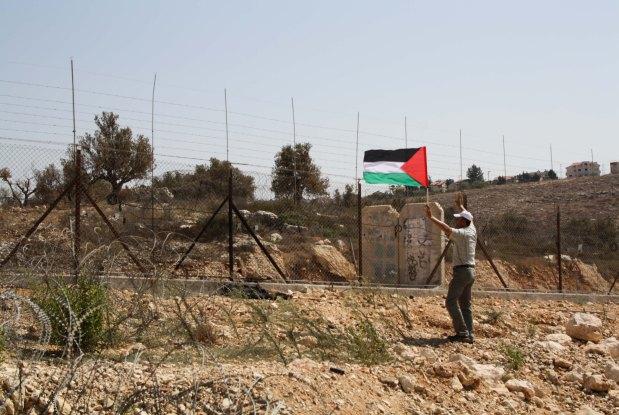 Ni'ilin Popular Struggle Committee Member is Seen Approaching Soldiers. Photo by Joseph Dana