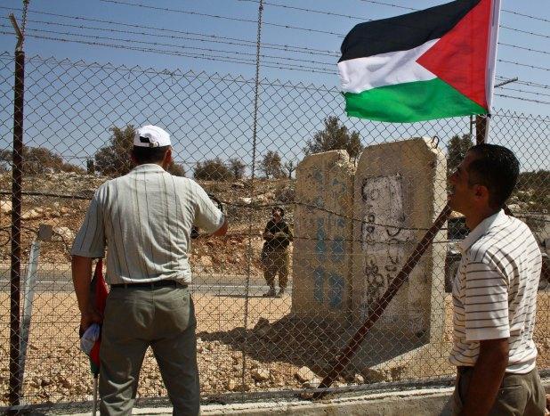 Palestinians Talk with Soldiers in Ni'ilin. Photo by Joseph Dana.