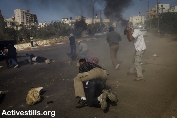 Undercover Israeli police officers detain a protester during clashes in Umm el-Fahm October 27, 2010 (photo: Oren Ziv)