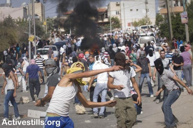 Demonstrators throw stones at Israeli police during clashes in Umm el-Fahm October 27, 2010.