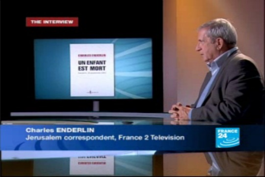 "Charles Enderlin discussing ""Un Enfant est Mort"" in the France 24 studio (photo: screenshot, France 24)"