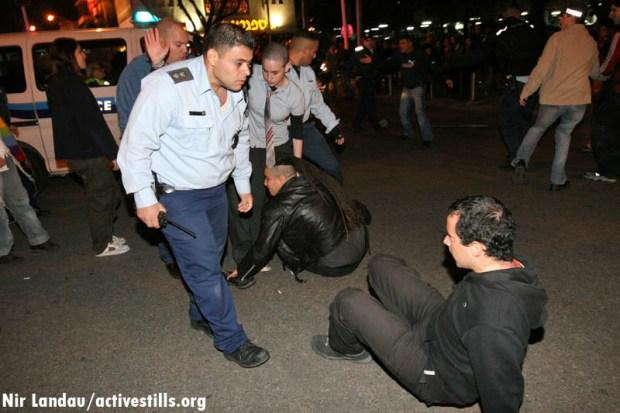 Police dispersing a protest against domestic violence in Tel Aviv (image: Nir Landau/activestills.org
