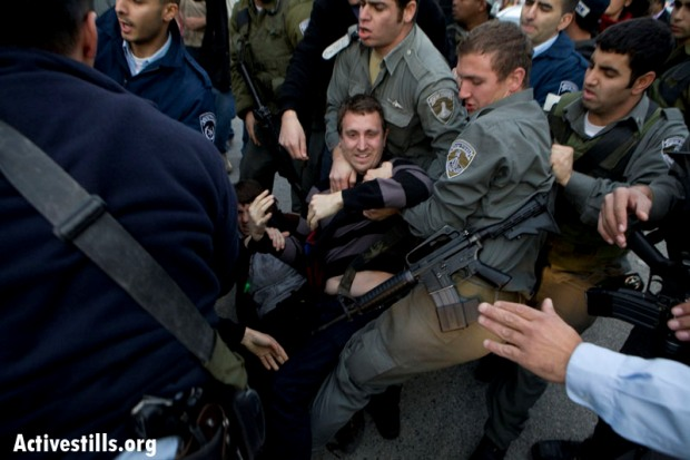 Protester arrested during a leftwing rally (image: activestills.org)