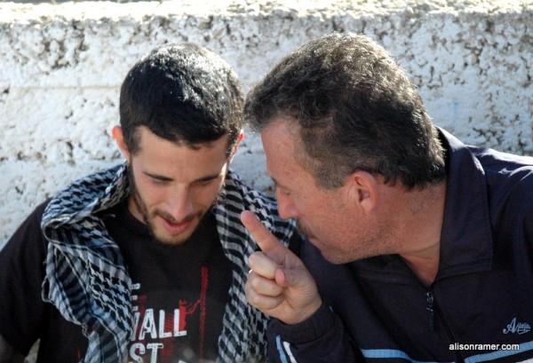 Protest organizer Bassam Tamimi with an Israeli activist in Nabi Saleh (photo: Alison Avigayil Ramer)