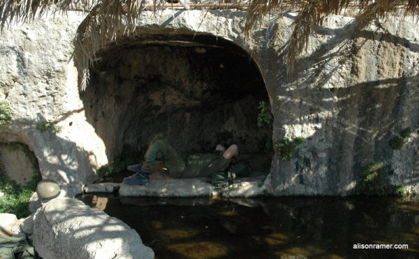 An Israeli soldier takes a nap in Nabi Saleh's spring (photo: Alison Avigayil Ramer)