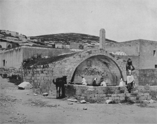 """Nazareth's """"Mary's Spring"""" in 1894. The hill in the background is the site of today's Upper Nazareth."""