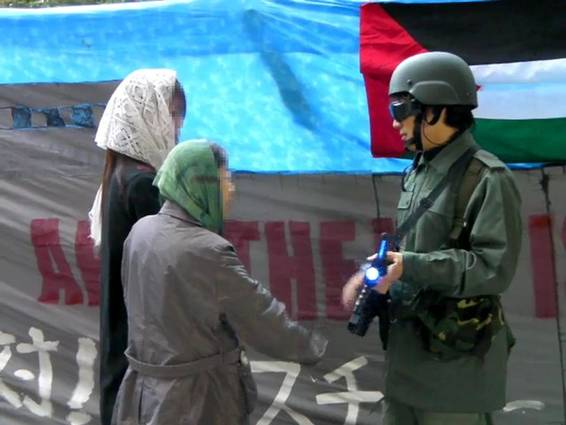 BDS Action in Front of MUJI Stores in Japan. While trying to look like IDF soldiers, there outfits looked more like space suits. Photo: Palestine Forum Japan