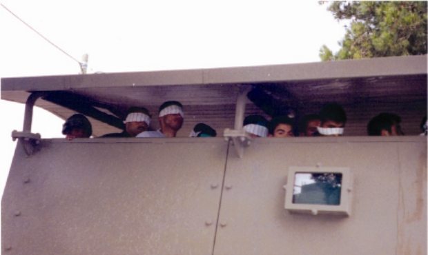 Palestinian prisoners held at the back of an army vehicle near Ramallah (photo: Breaking the Silence)
