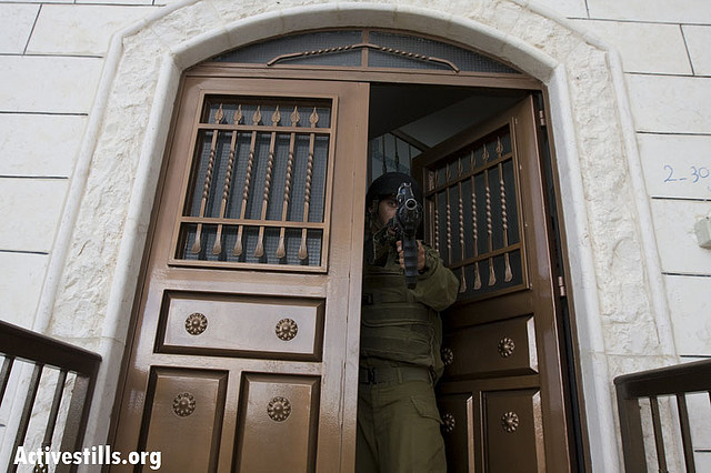 IDF Soldier During a House Raid near Hebron. Photo:Meged Gozani/Activestills.org