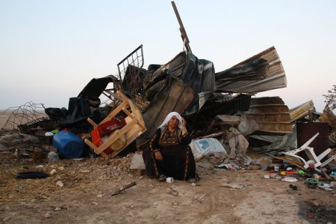 A Bedouin woman sits in front of her rebuilt home in al-Araqib after it was destroyed by Israeli forces, again. (Joseph Dana)