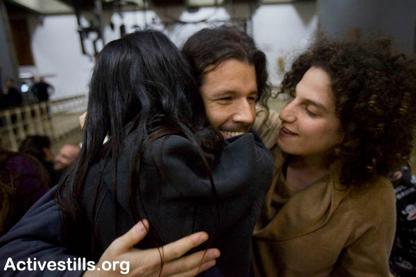 Activists Embrace Each Other After Being Released from Jail 4.1.2010. Photo: Oren Ziv/Activestills.org