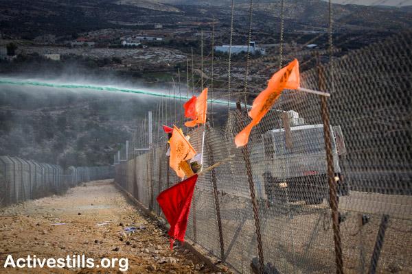 The 'Skunk' in action today in Bil'in. Picture Credit: Oren Ziv/Activestills.org