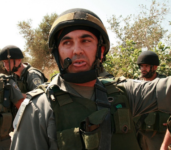 Border police officer who threw the percussion grenade. Nabi Saleh, 18 June 2010. (Photo: Lisa Goldman)