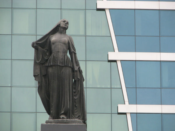 The monument to women's liberation in central Baku displays a woman removing her headscarf. Is she still Muslim? In the Azeri sense, she is.