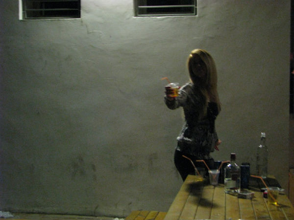 """Woman """"fueling"""" before going clubbing in Tel Aviv's rough and rowdy Yad Harutzim district (photo: Yuval Ben-Ami)"""