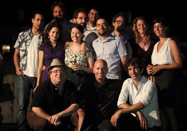 Members of the +972 team at the toast, standing (right to left): Mairav Zonszein, Dahlia Scheindlin, Joseph Dana, Roi Maor, Aziz abu-Sarah, Dimi Reider, Shir Harel, Noa Yachot, Yuval Ben-Ami & 972's friend Issa Edward Bourseh. Kneeling: Noam Sheizaf, Ami Kaufman, Yossi Gurvitz (photo: Shalom Boguslavsky)