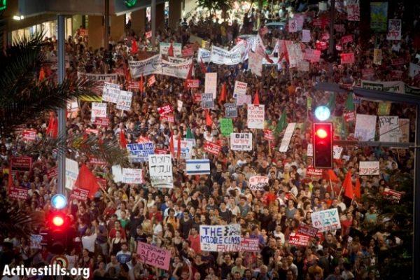 Israelis protesting in Tel Aviv in demand social justice, summer 2011. (Oren Ziv/Activestills)