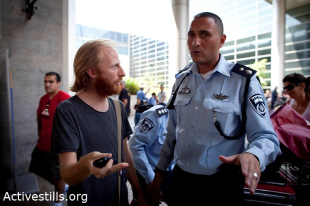 More than 100 arrested at TLV airport, moved to Israeli prison