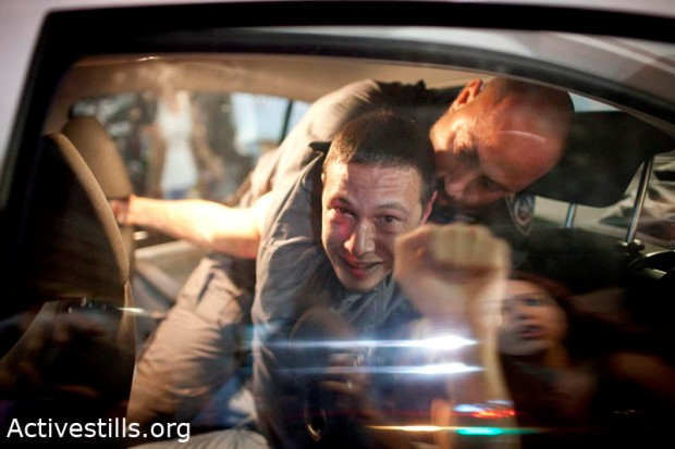 Arrest of a protester in Tel Aviv following rally over housing prices  (photo: Oren Ziv/Activestills)