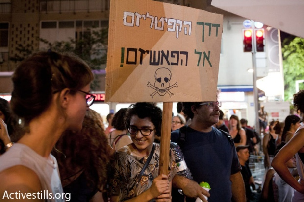 "Sign at protest: ""through capitalism to facism"" (photo: Keren Manor/activestills)"