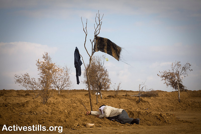 A Bedouin in the village of Al Arakib after it was destroyed by Israeli forces. Photo by activestills.org