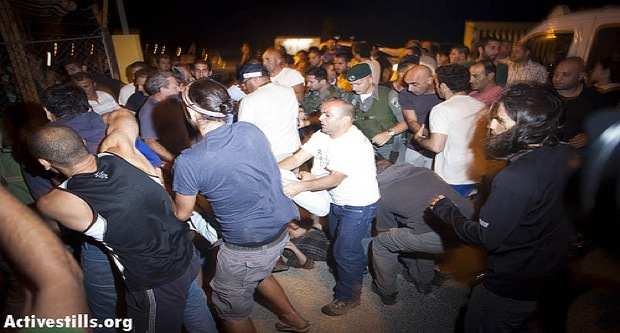 Settlers clash with border police and activists (Photo: Activestills)