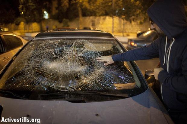 Smashed car windshield (Photo: Activestills)