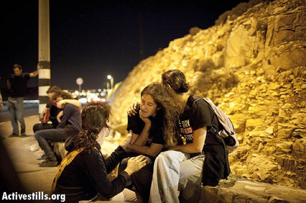 Activists consoling each other after attack (Photo: Activestills)