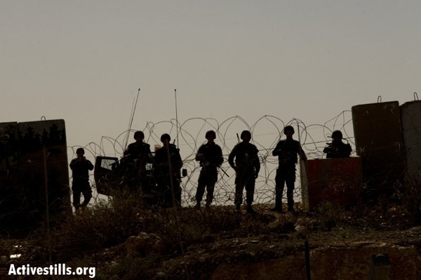 Protest against the apartheid wall, Bilin, Palestine, 07/11/2008 (photo: Activestills)