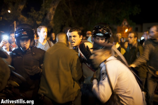Police, protesters clash in front of Likud headquarters in Tel Aviv