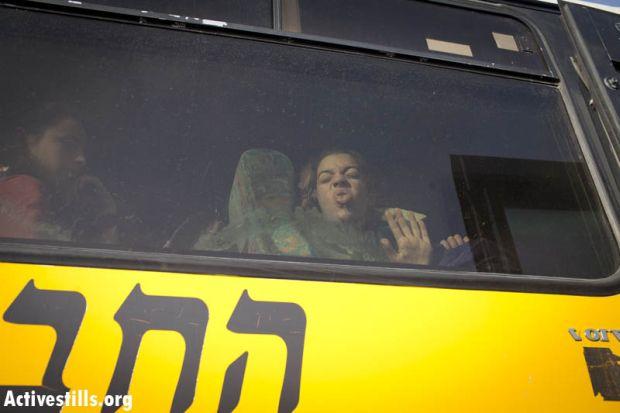 An Israeli schoolgirl sticks her tongue out at Palestinian activists (Photo: Activestills)