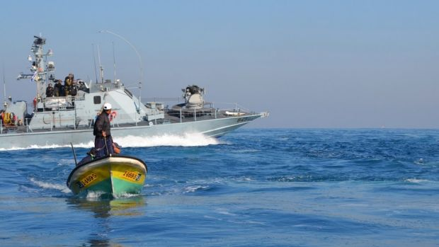An Israeli warship approaches a Palestinian skiff, as photographed from the observation boat Olivia (photo: Rosa Schiano/Civil Peace Service Gaza CPSGAZA)