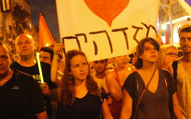 Daphni Leef (R) and Stav Shafir at a summer demonstration in Tel Aviv (photo: Dafna Talmon)