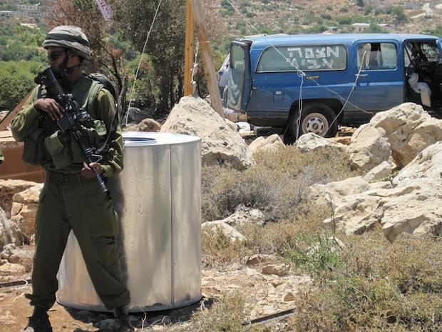 """IDF protecting Hilltop 18; """"Mitzpeh Avichai"""" written on van (photo: Mairav Zonszein)"""