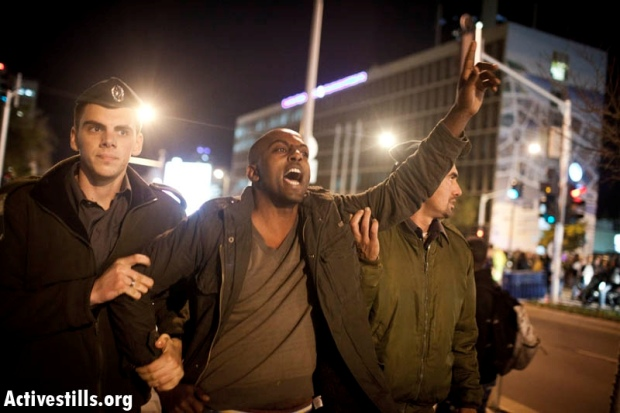 Arrest of protester at a demonstration opposing the discrimination and racism against Ethiopian-Jews in central Tel Aviv, January 31, 2012 (photo: Oren Ziv/ Activestills.org)