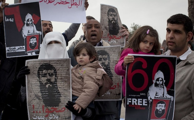 The wife and daughters of Khader Adnan at a protest outside Ziv Medical Center in Safed (photo: Oren Ziv / Activestills)
