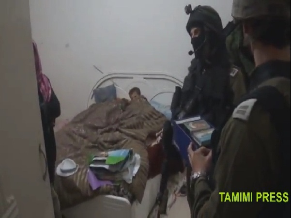 Soldiers in a children's bedroom in Nabi Saleh (from a video by Bilal Tamimi)