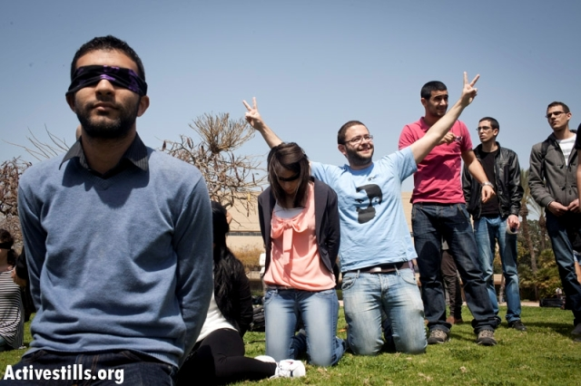 Im Tirzu activist fitting himself into a student protest in TAU for the release of Hana Shalabi (Oren Ziv / Activestills)