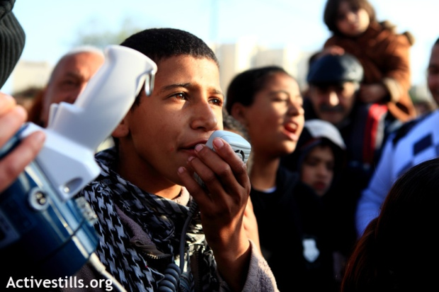 Palestinian children from Lod chant at the weekly protest in Sheikh Jarrah, January 28, 2011. (photo: Anne Paq/Activestills)