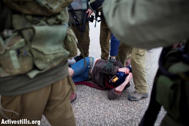 Soldiers in Ma'asar aarresting an Israeli demonstrator (Oren Ziv / Activestills)