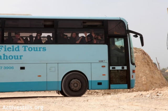 Harvard students held inside a bus in Al-Walaja (Anne Paq / Activestills)