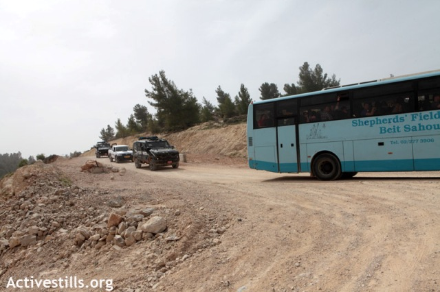 The bus escorted out of Al-Walaja (Anne Paq / Activestills)