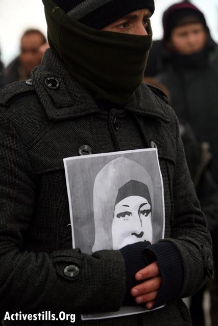 Demonstrator carrying Hana Shalabi's picture in Nabi Saleh (Oren Ziv / Activestills)