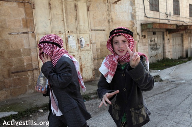 Jewish kids dressed as Arabs for Purim in the segraged Shuhada St. (Anne Paq / Activestills)